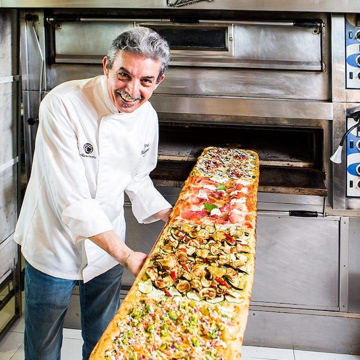 ¡Pizza por metros + bebidas en Kilómetros de pizza!